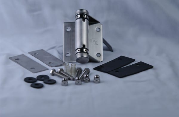 Stainless steel hinges, screws and nut bolt kept on white background