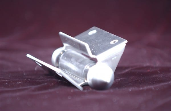 Upper view of stainless steel hinge on red background