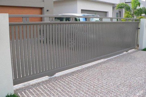 Automatic grey sliding gate in a private house