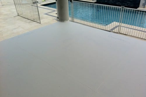 Balcony view of pool surrounded with aluminium fencing
