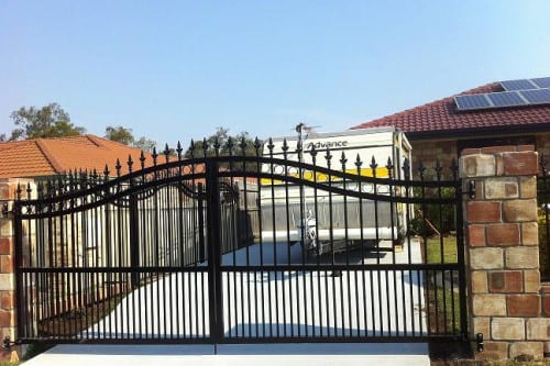 Metal black driveway gate for a house