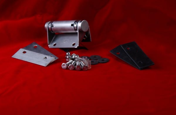 Variety of stainless steel door hinges with screws kept on red cloth