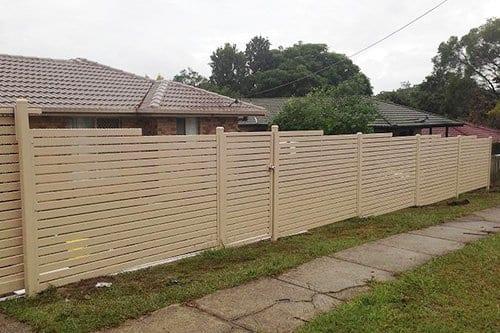 White metal gate built outside a single-story house
