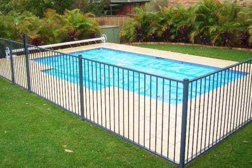 Backyard pool with black aluminium fence