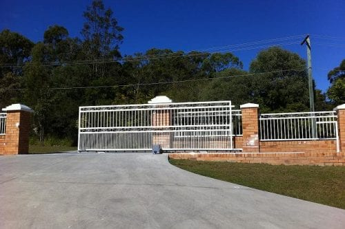 Huge white cantilever gate built on the drive-way